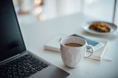 Modern white office, designer handmade cup with coffee, smartpho stock images