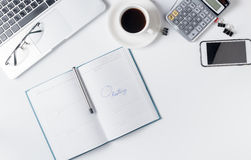 Modern white office desk table with laptop Stock Images