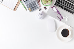 Modern white office desk table with laptop, mouse and other supp Royalty Free Stock Photography