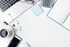Modern white office desk table with laptop Royalty Free Stock Photo