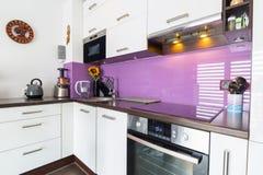 Modern white kitchen interior. Modern white and purple kitchen interior stock photo
