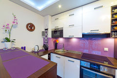 Modern white and purple  kitchen Royalty Free Stock Image