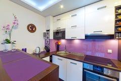 Modern white and purple  kitchen. Interior of modern white and purple kitchen Royalty Free Stock Image