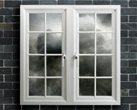 Modern white pvc window with view of stormy sky Stock Photos