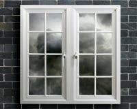 Modern white pvc window with view of stormy sky Stock Photos