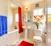 Modern white and red beautiful bathroom. Royalty Free Stock Photos
