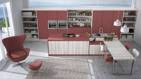 Modern white and red kitchen with wooden details, big window wit Stock Photography