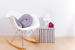 Modern white rocking chair and wall Stock Photo