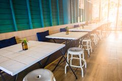 Modern white row table in restaurant before service.  royalty free stock photography