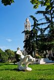 Modern Sculpture, Reclining Female Figure, Tirana, Albania. A modern white sculpture of a reclining female figure, in a park in central Tirana, Albania, with the royalty free stock image