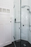 Modern white shower in bathroom renovation with brick pattern ti Stock Photo