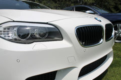 Modern white sports sedan front detail Royalty Free Stock Images