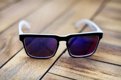 Free Modern  White Sun Glasses With Mirror Glasses Isolated On A Wooden Background Stock Photography - 47823572