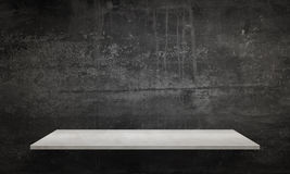 Modern white table with legs and free space. Black wall texture in background Royalty Free Stock Photography