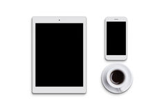 Modern white tablet, cell phone and cup of coffee isolated over white background. Electronic devices. Desktop. Flat view of gadget Stock Image