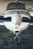 Modern white ultralight sport airplane in hangar.  Royalty Free Stock Photos