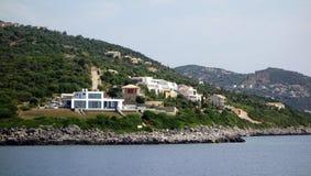 Modern White Villa, Lefkada Greek Island, Greece. Modern Villas set amongst olive trees on a rugged oceanside hill, Lefkada, and Ionian Greek Island, Greece Royalty Free Stock Photography