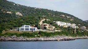 Modern White Villa, Lefkada Greek Island, Greece. Modern Villas set amongst olive trees on a rugged oceanside hill, Lefkada, and Ionian Greek Island, Greece Royalty Free Stock Photo