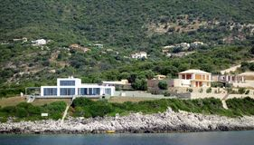 Modern White Villa, Lefkada Greek Island, Greece. Modern Villas set amongst olive trees on a rugged oceanside hill, Lefkada, and Ionian Greek Island, Greece Stock Image