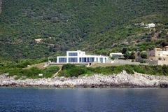 Modern White Villa, Lefkada Greek Island, Greece. Modern Villas set amongst olive trees on a rugged oceanside hill, Lefkada, an Ionian Greek Island, Greece Royalty Free Stock Images
