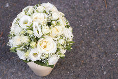 Modern white wedding bouquet. Made of roses Stock Photos
