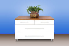 Modern white wooden chest of drawers Royalty Free Stock Image