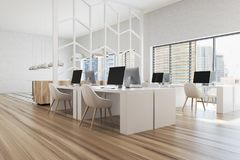 Modern white and wooden office corner pattern. Modern white office corner with white walls, panoramic windows and white computer tables. A wooden floor, a side royalty free stock photography