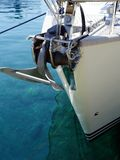 Stainless Steel Sea Anchor on Modern Yacht, Greece. A modern white yacht moored on Skyros, a Sporades Greek Island, with stainless steel fittings including a sea Royalty Free Stock Images