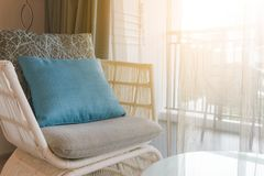 Modern wicker chair with cushion and comfort pillow in room. Near by the window. Modern wicker chair with cushion and comfort pillow. Near by the window royalty free stock image