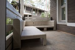 Modern wicker furniture on terrace. In country house stock images