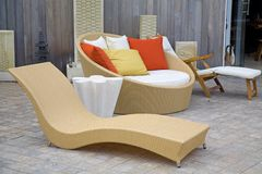 Modern Wicker Garden Furniture. On the home patio stock photography