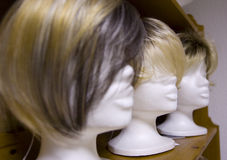 Modern wigs in a row. Modern styled wigs in a row, focus on the one in the middle Stock Images
