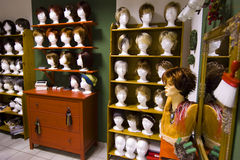 Modern wigs in a shop. Modern styled wigs in a decorated shop Stock Image