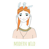 Modern wild. Beautiful young woman with headphones. Dressed in the style of American Indians. Red hair Stock Photos