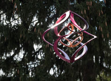 Modern Wind Spinner in Purple and Silver Stock Images