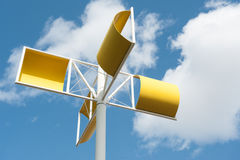 Modern wind turbine made from yellow steel Stock Images