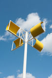 Modern wind turbine made from yellow steel Stock Photo