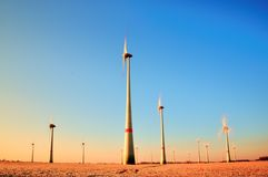 Modern Wind Turbines Producing Energy in sunny spring morning. Vintage Style Toned effect Royalty Free Stock Images