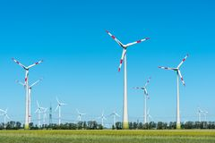 Modern wind turbines on a sunny day Stock Images