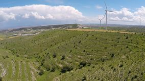 Modern wind turbines surrounded by beautiful nature, green energy generation. Stock footage stock video footage