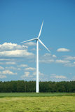Modern windmill on field. In summer day Royalty Free Stock Photos