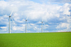 Modern windmill in a field Royalty Free Stock Images