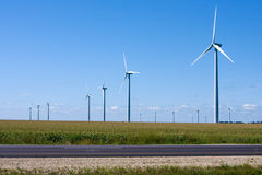 Modern Windmill Generators along the Interstate Royalty Free Stock Photos