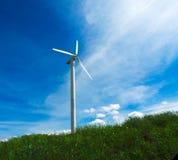 Modern windmill turbine, bottom view. Modern windmill turbine against a blue and cloudy sky stock image
