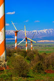 Modern windmills and Hermon Stock Images