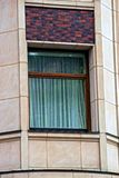 Modern window with curtains on the building of the apartment house royalty free stock photo