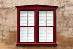 Modern Window on Stucco Wall. Brown stucco wall with modern red wooden window frame Royalty Free Stock Photos