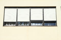 Modern windows with curtains Stock Image