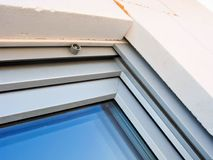 Modern windows installation detail. A detail of a modern window installation showing internal integrated shutters and polystyrene wall insulation royalty free stock photos
