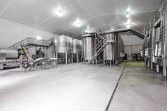 Modern wine cellar with stainless steel tanks. Modern industry for manufacturing and maturing of wine. steel tanks inbox and vision of all floors of the factory Stock Photography